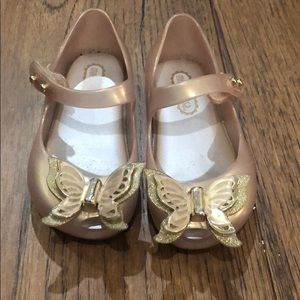 Gold mini Melissa shoes with butterflies